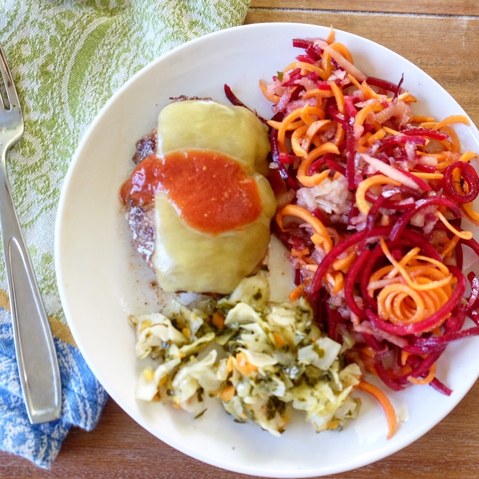 "a typical ""after meal"": grassfed full fat beef with raw cheddar and fermented ketchup,, homemade fermented veggies, raw carrot and beet salad dressed with flax oil and balsamic."