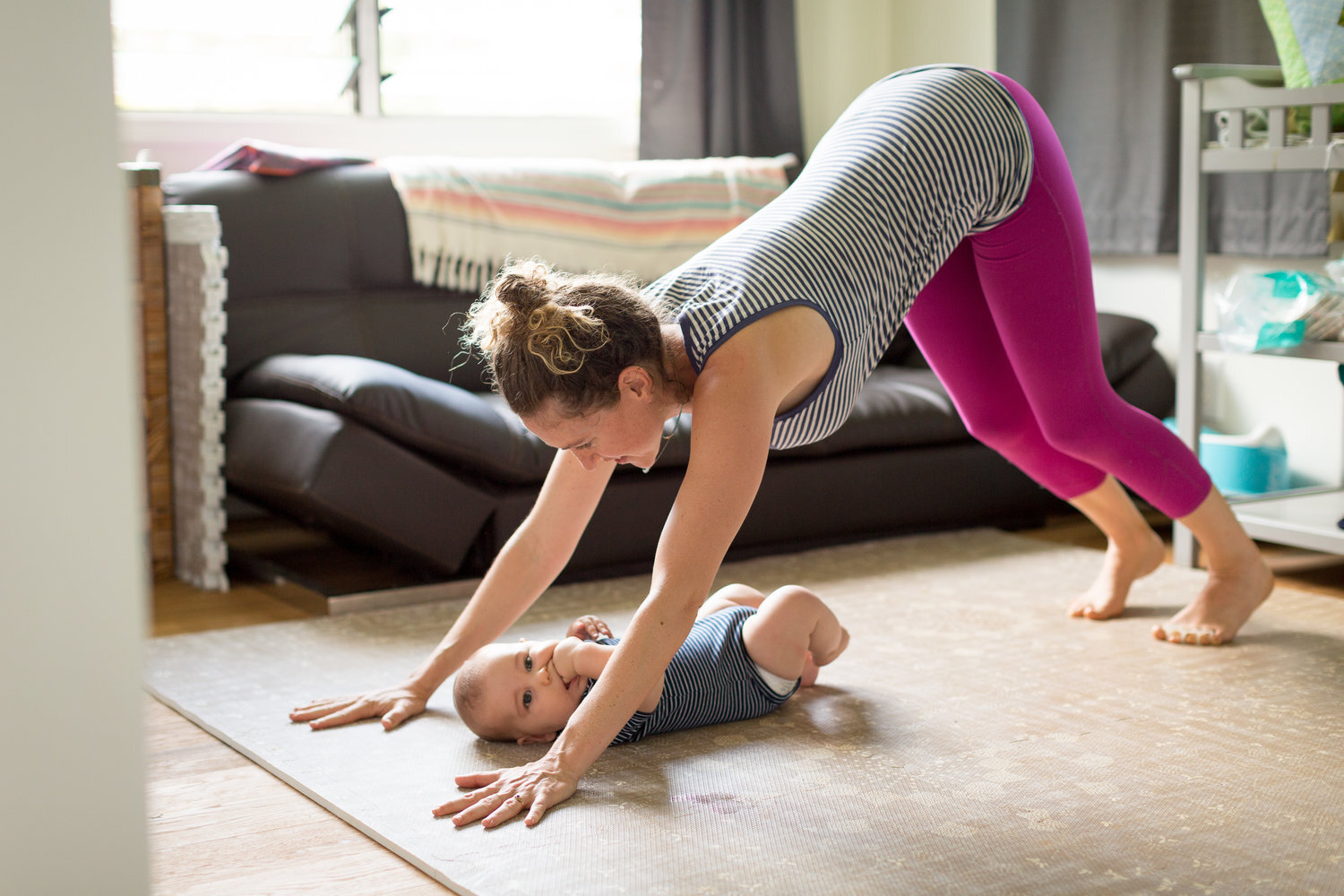Play on the mat with your baby for both their enjoyment and yours