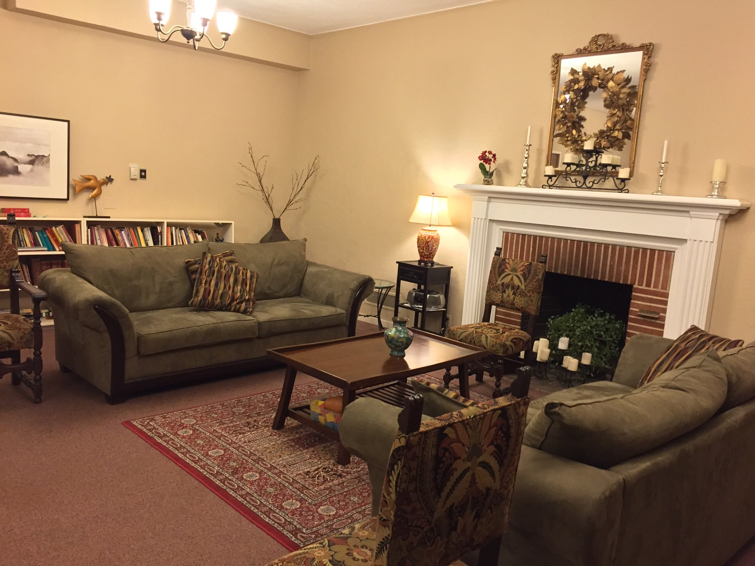 Fireside Room - The Fireside Room is an intimate gathering space for 5-45. Arranged in a living room style, the 3 couches, 4 armchairs, and various stackable chairs make a cozy place for conversation, presentation, meeting, or even knitting!
