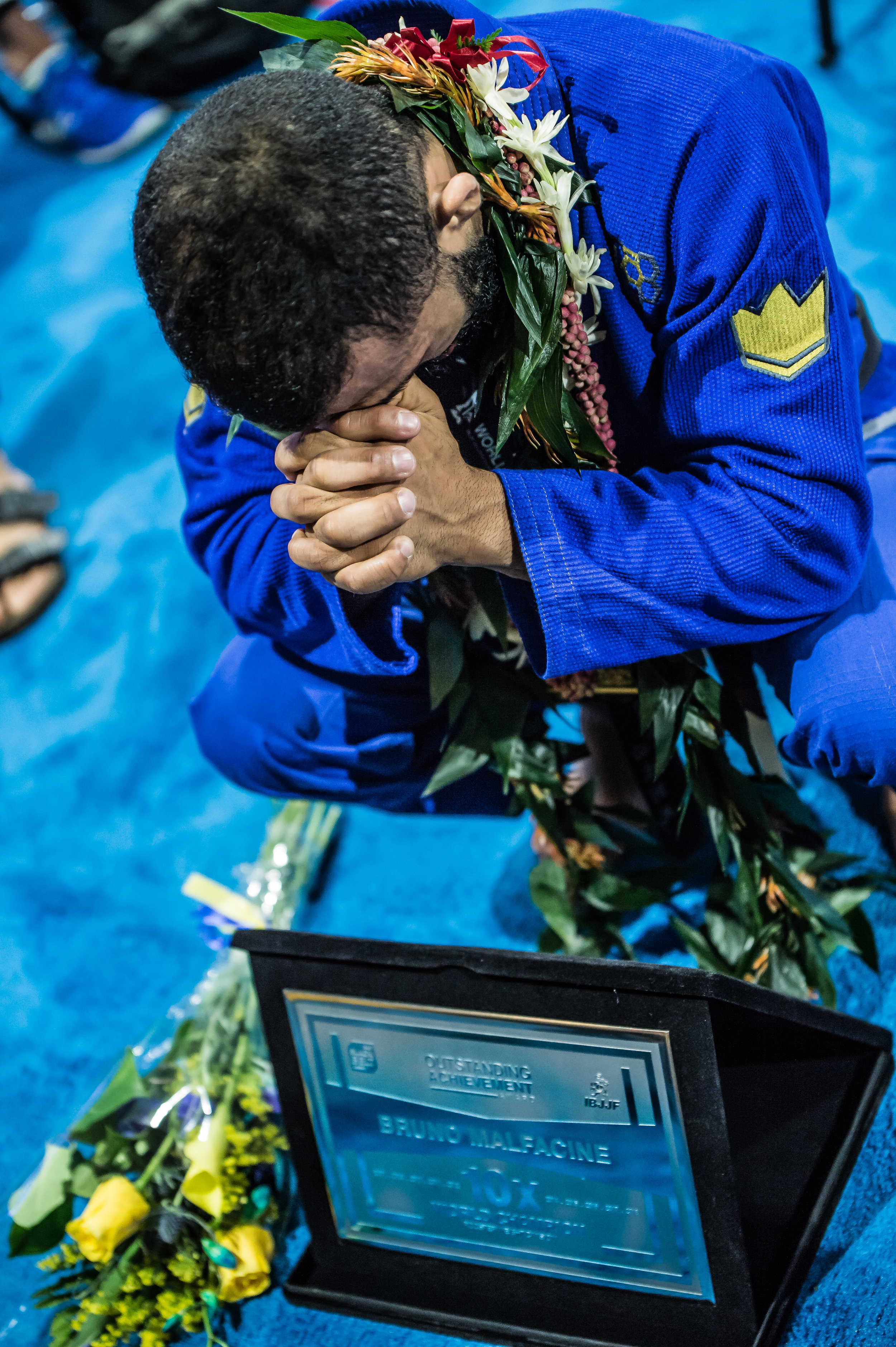 After winning his record 10th Rooster Weight Division Championship, Bruno Malfacine was invited back up to the podium to receive special recognition from the IBJJF for this accomplishment. He stepped off the podium and needed a moment to collect himself.