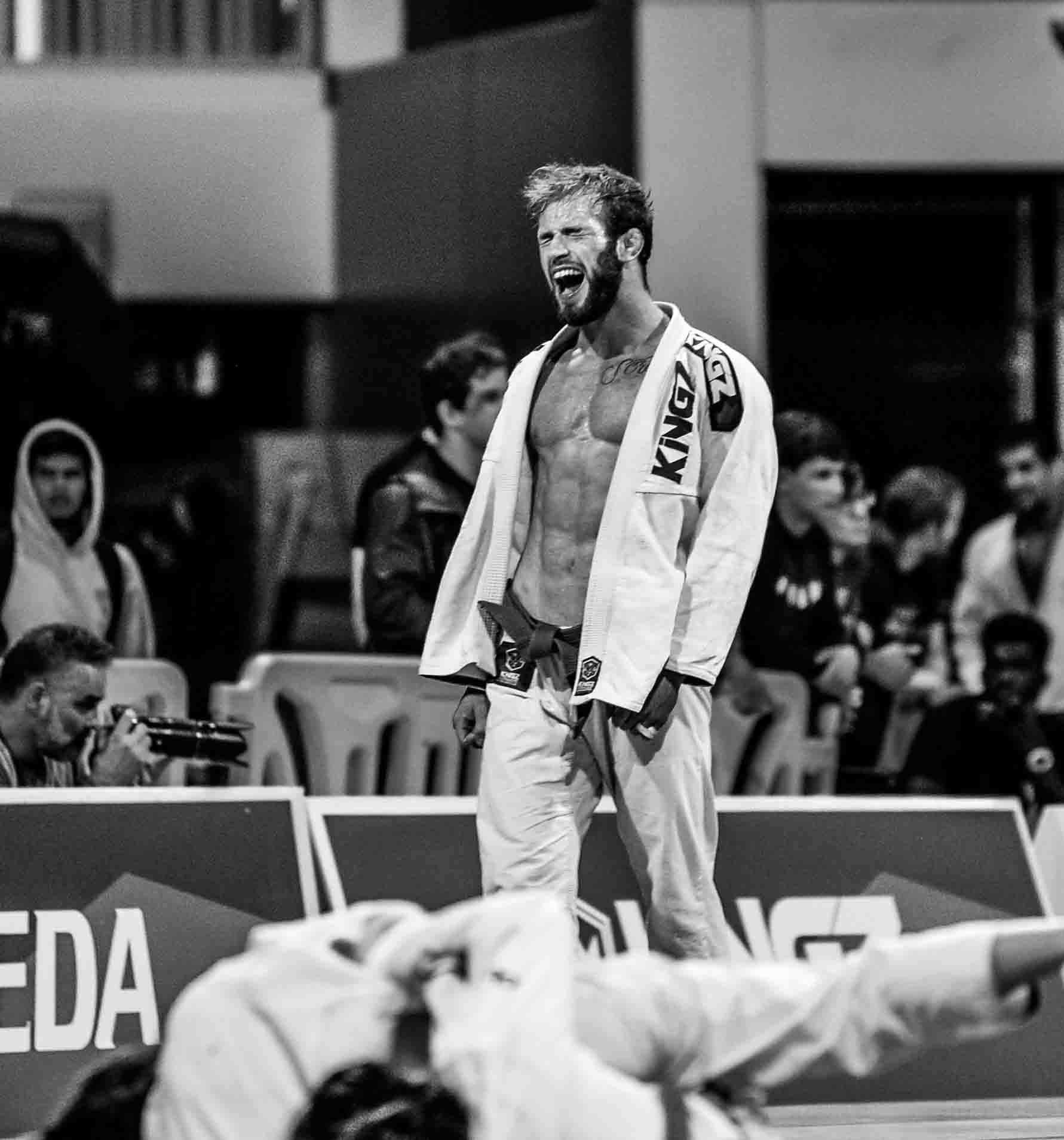 Purple Belt Adam Bradley of Atos Jiu Jitsu lets out a victory yell after moving on to the finals.