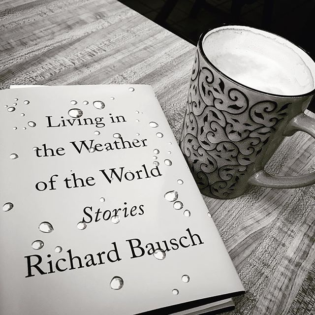 Cafe au lait and a good book #richardbausch #livingintheweatheroftheworld