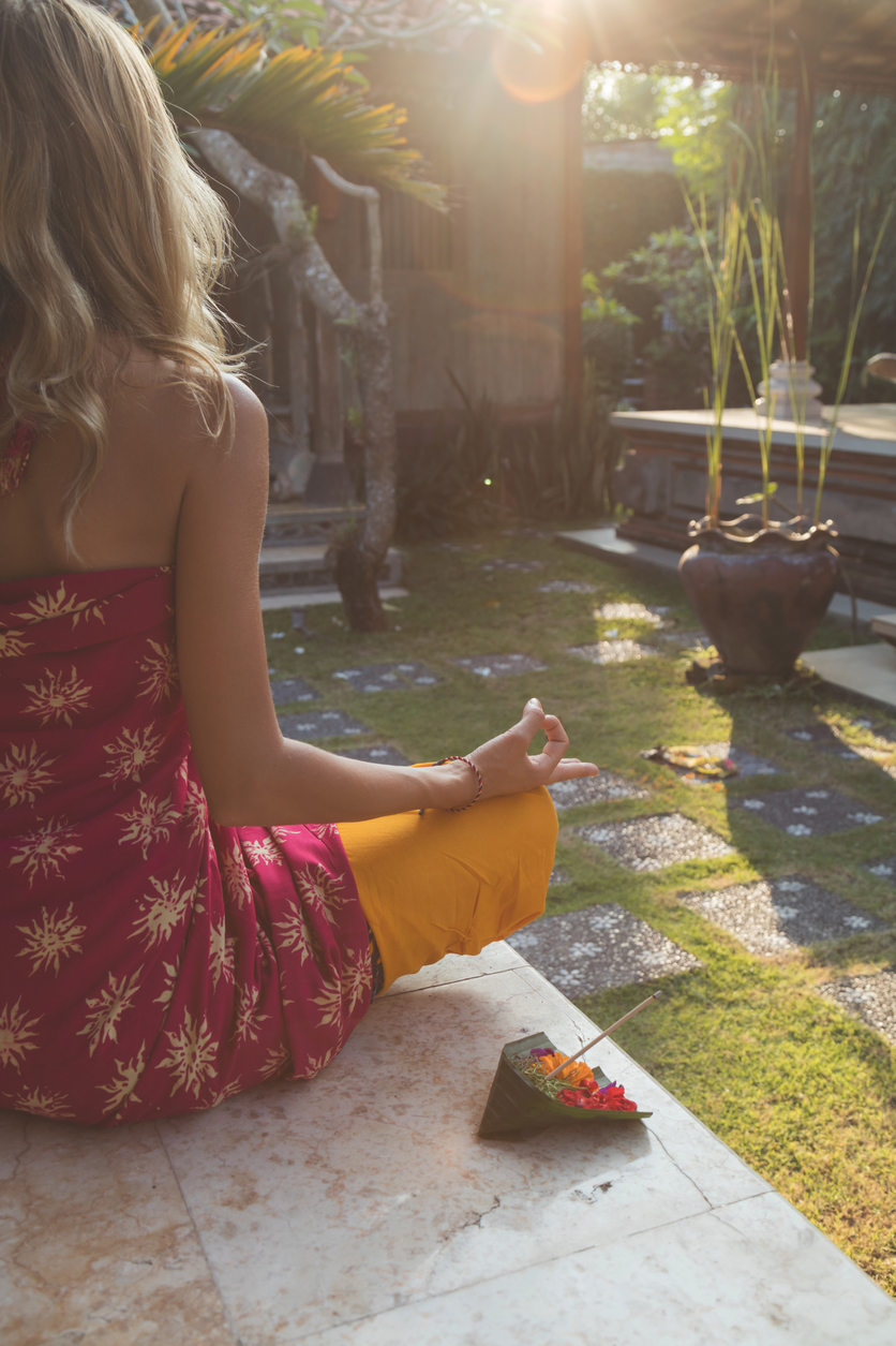 Young-woman-practicing-yoga-in-the-tropical-garden,-691570102_839x1258 (1).jpeg