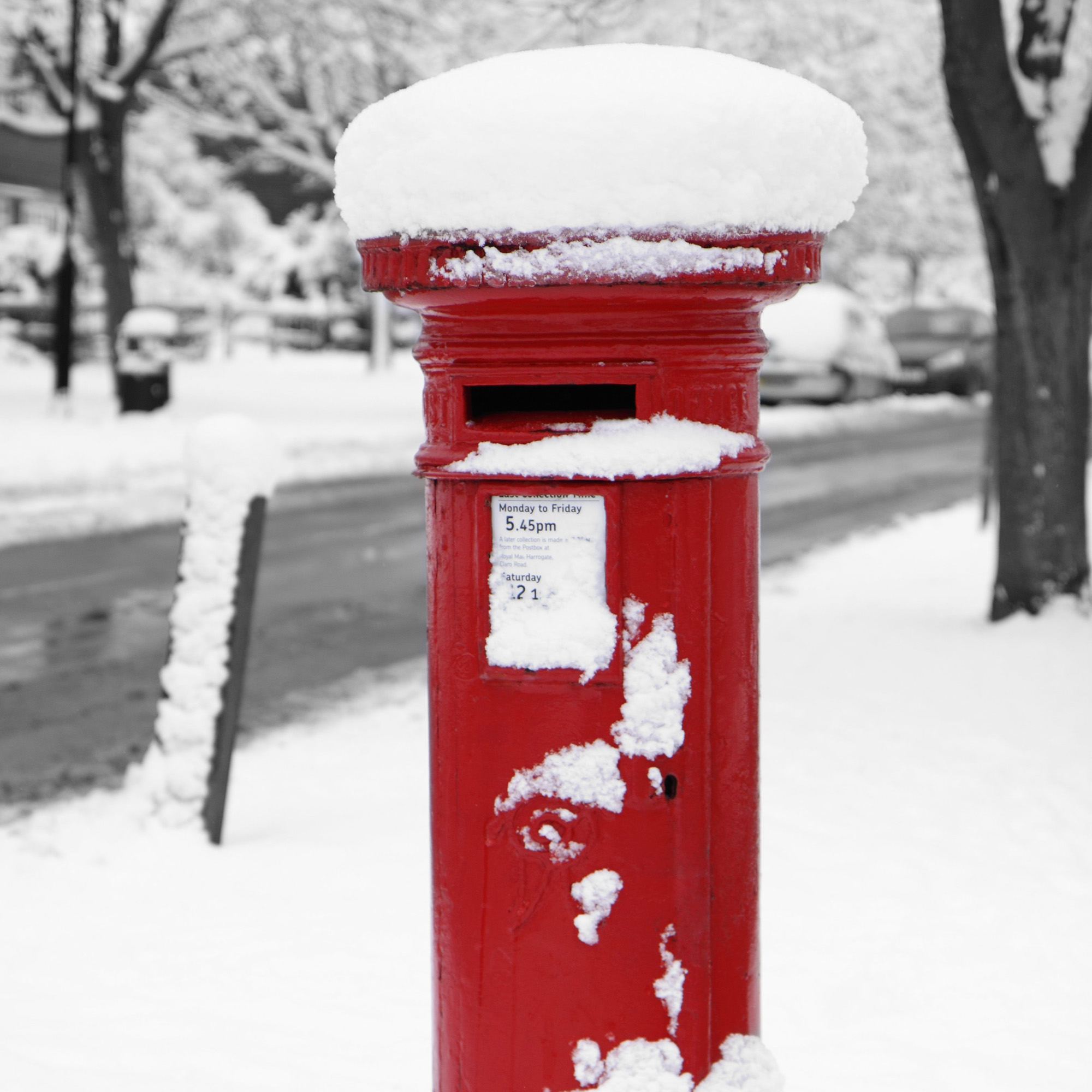 english postbox in snow