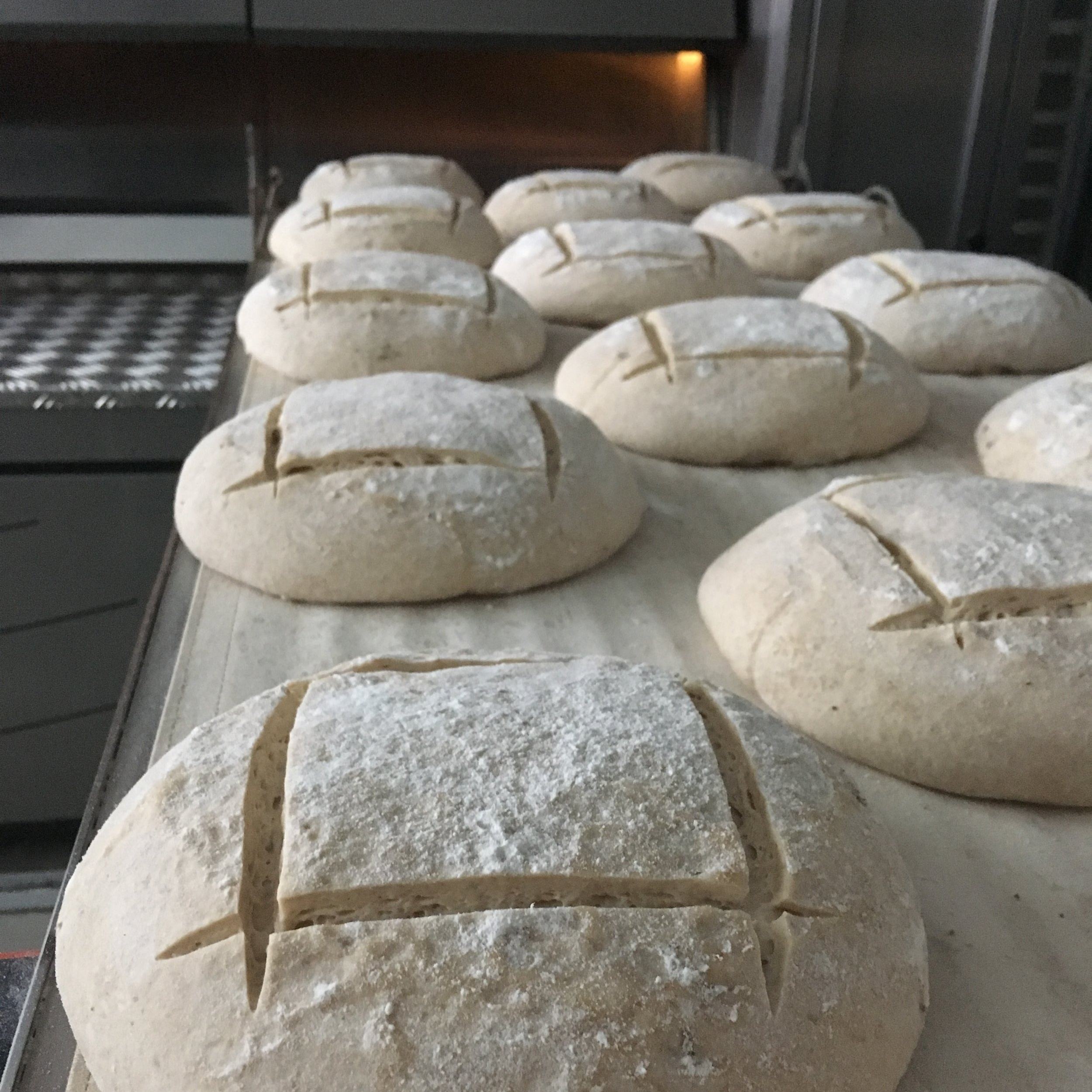 At the Bakery - Our flour is organic, our bakery small and our products individually handcrafted. From croissant, to 5 grain, parmesan pepper and olive breads offering premium quality created with mindfulness is our joy. And don't forget the Oh!s.
