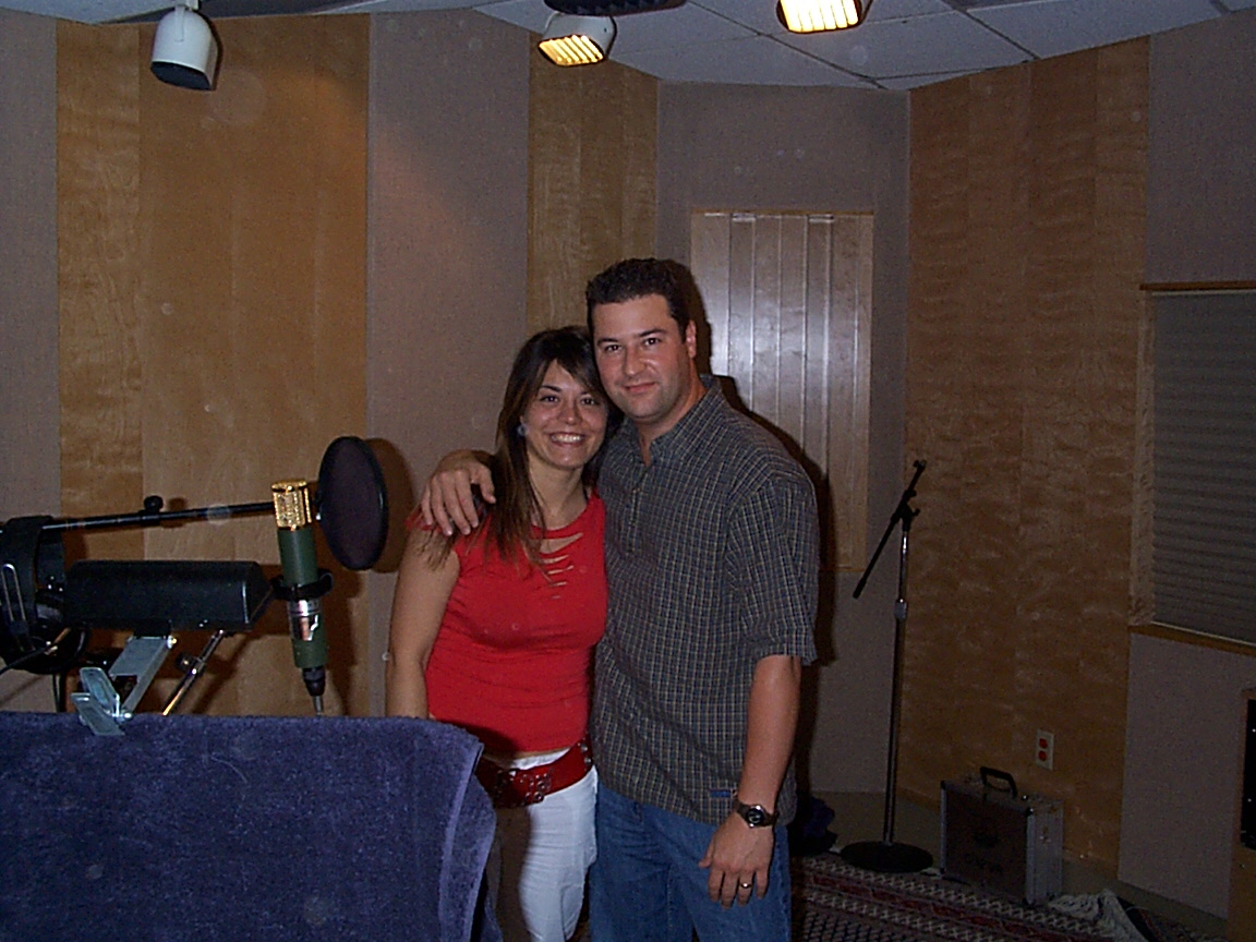 "In the vocal booth during tracking for ""Lo Bueno Queda""."