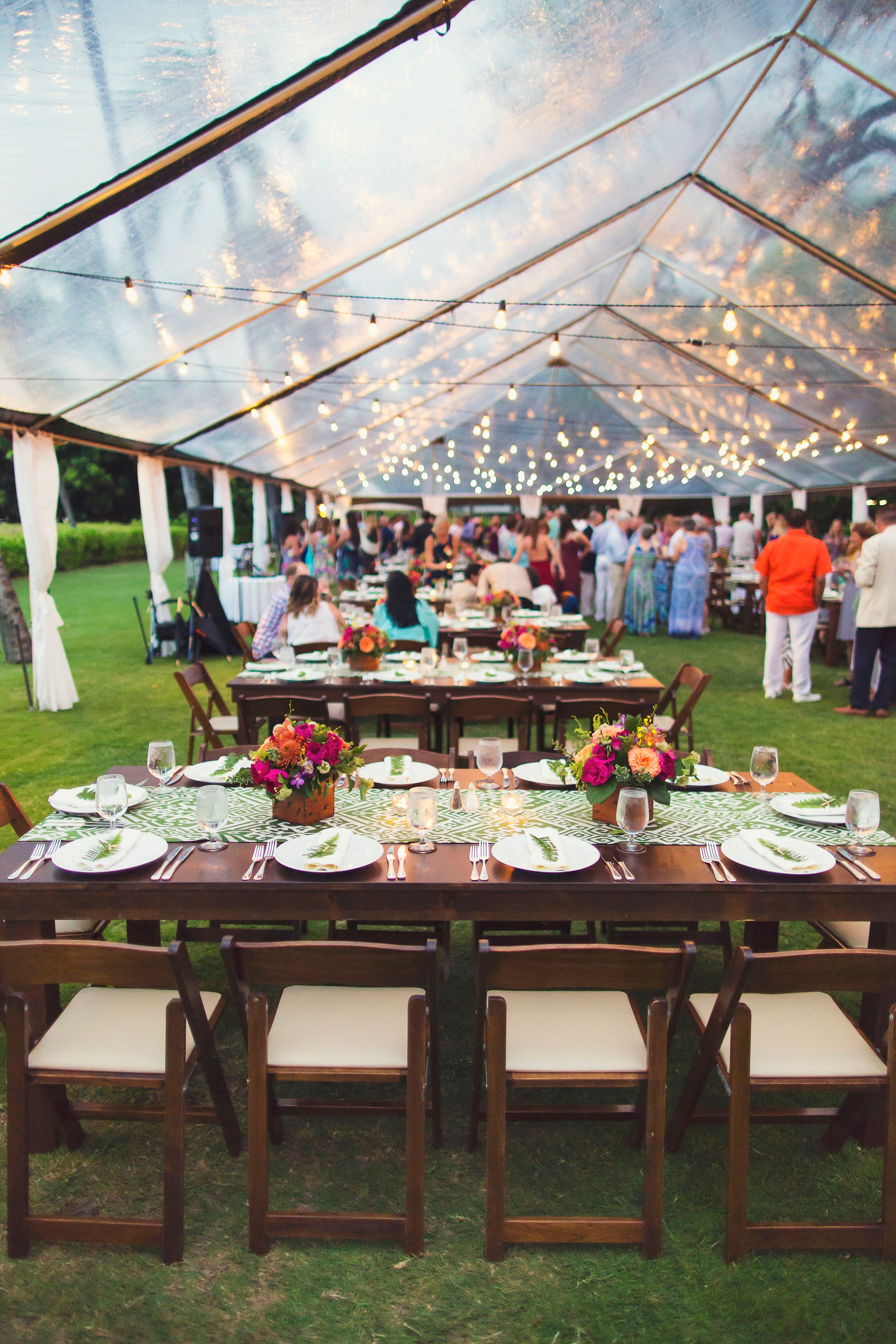 Farm Tables, Dark Wood Padded Folding Chairs, 40x Clear Tent, Market Lighting, and Thin White Leg Draping.   Coordination and Design  Bliss in Bloom  | Photography  Fletch Photography . | Location South point lawn  Maunakea Hotel