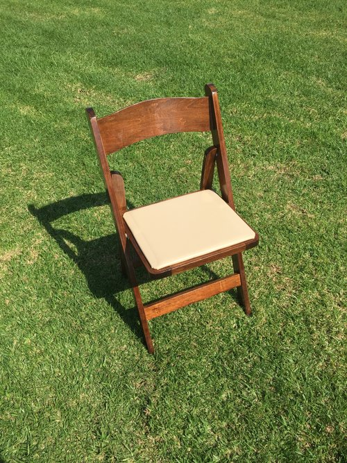 """White Padded Resin Folding Chairs  Dimensions: 19"""" wide x 17"""" deep x 30"""" tall"""