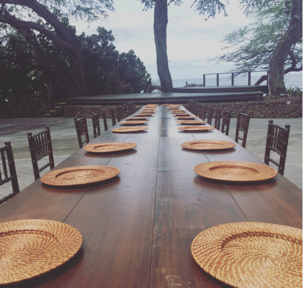 Rattan Chargers on long Farm Tables with Dark Wood Chiavari Chairs