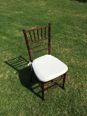 "Dark Wood Chiavari Chair with Ivory Cushion  Dimensions: 19"" wide x 17"" deep x 30"" tall"