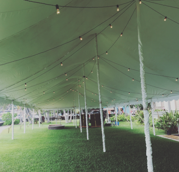 30x pole tent with white leg covers and market lighting for a wedding at  Hulihee Palace.
