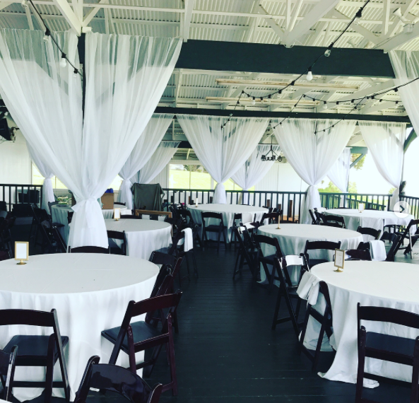 Sheer White Post-Draping and Farm Tables at  Kahua Ranch  for wedding with  Swept Away Events .