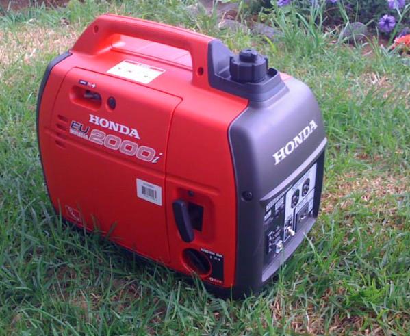 Honda 2000 Whisper Watt. Includes one full tank of gas.