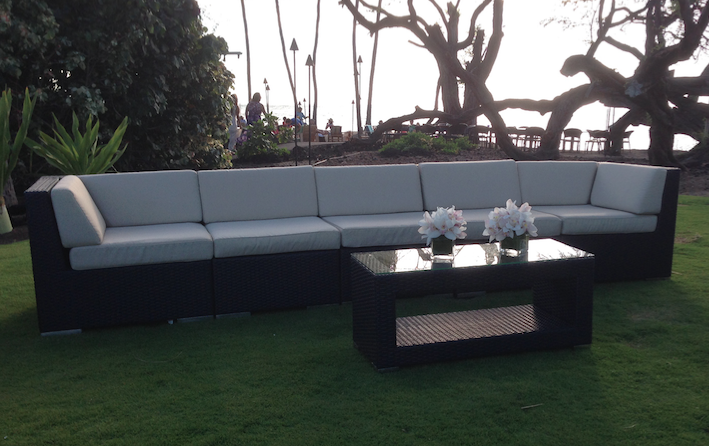 Black Wicker sectional with Creme cushions and matching Black Wicker Coffee Table