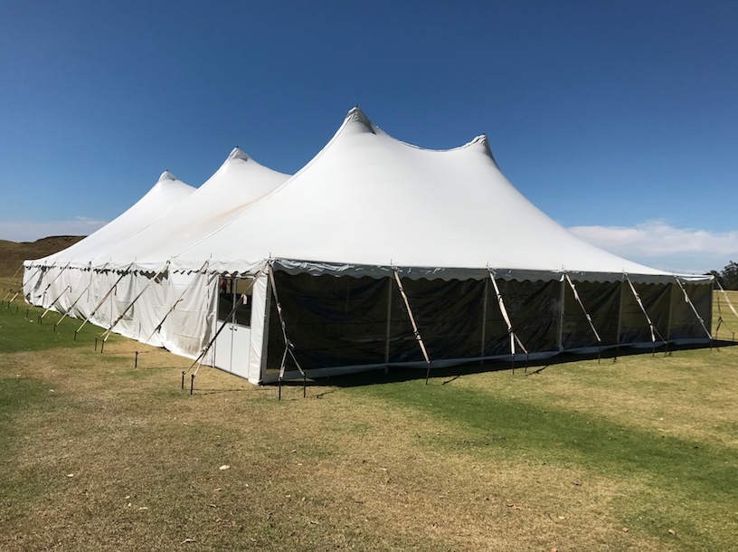 White Tents Featuring Tent Doors, White Side Curtains mixed with Clear Side Curtains.