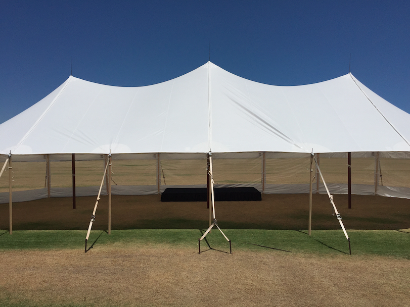 Black Staging under a Sail Cloth Tent.
