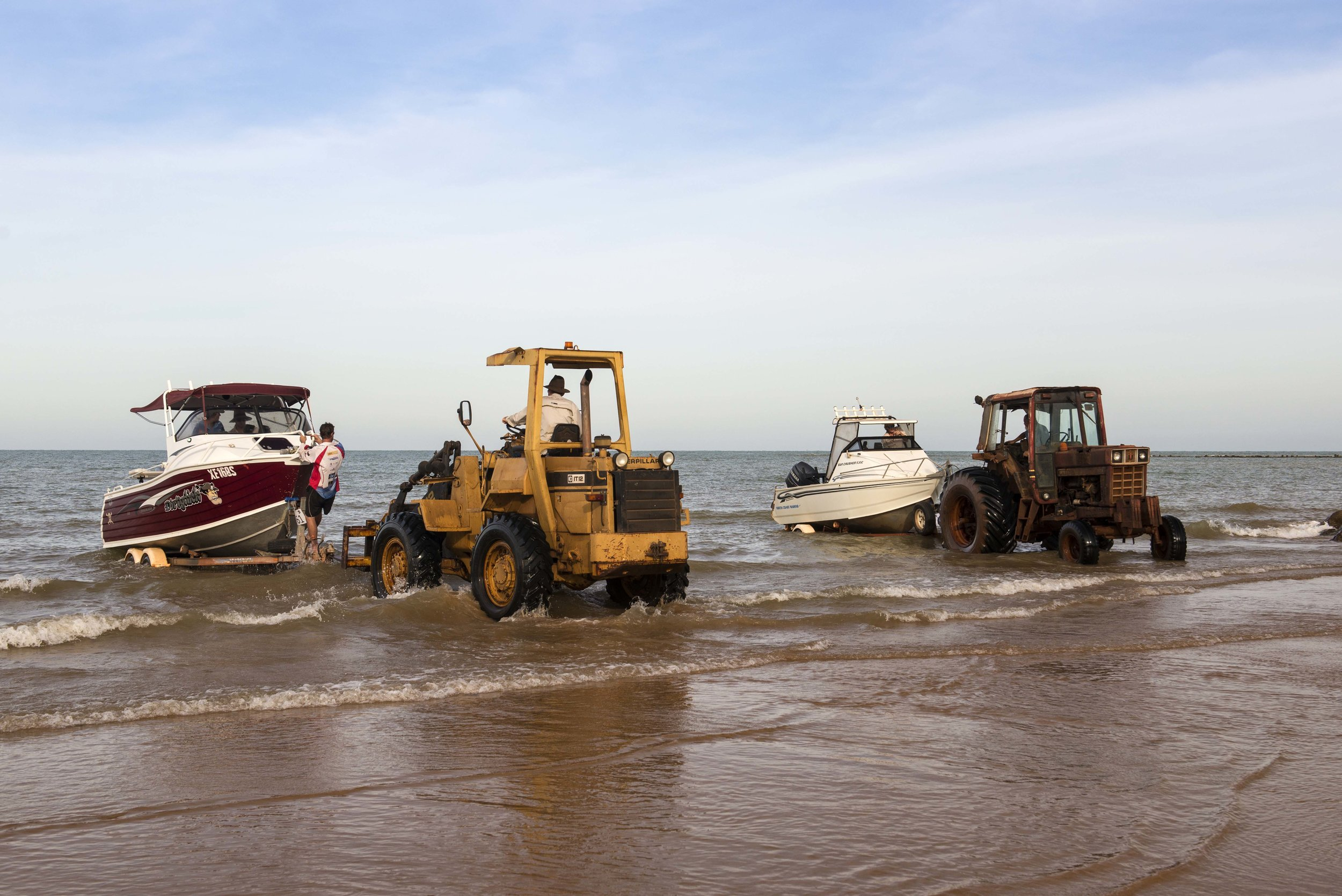 Tractors on the beach to launch boats.