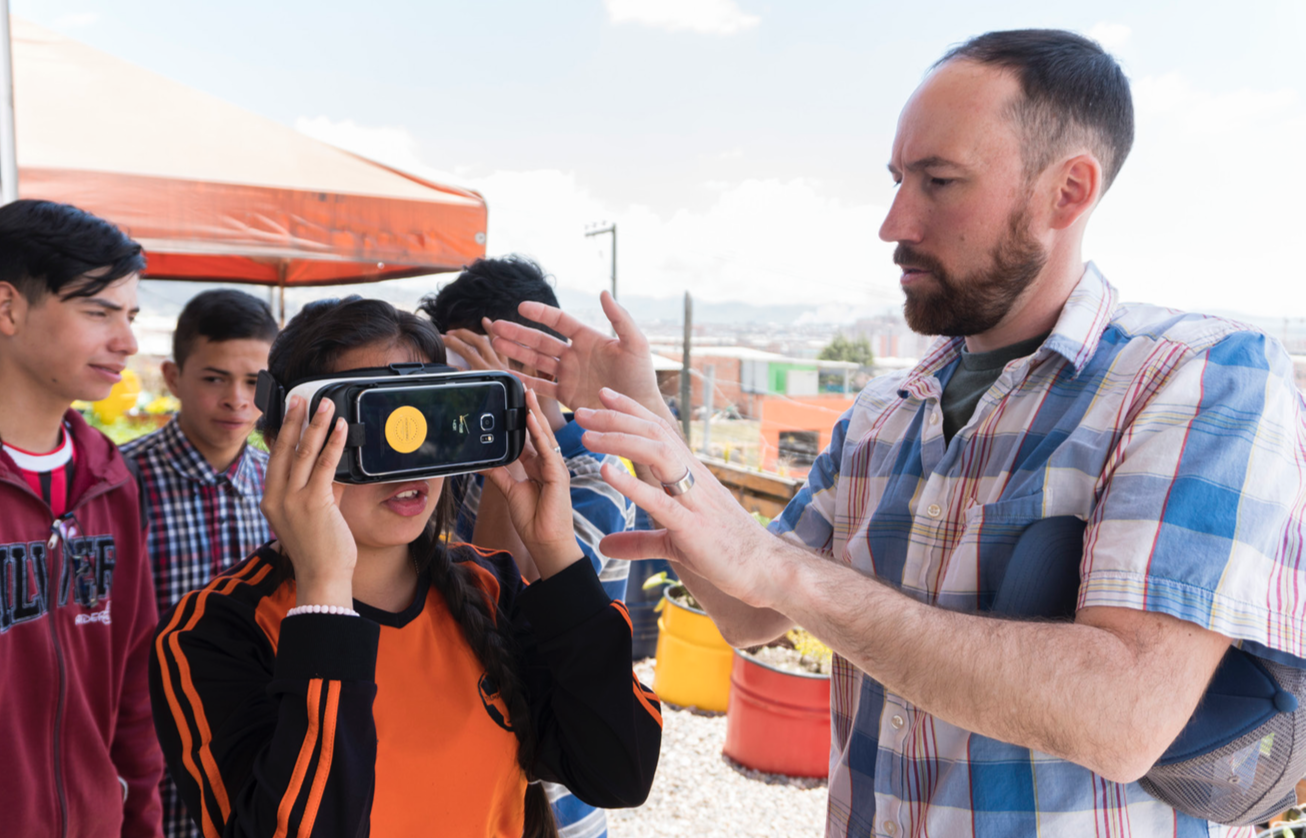 Cazuca, Colombia -  .360 Content Director Erik Scheel demonstrating VR video to high school students.