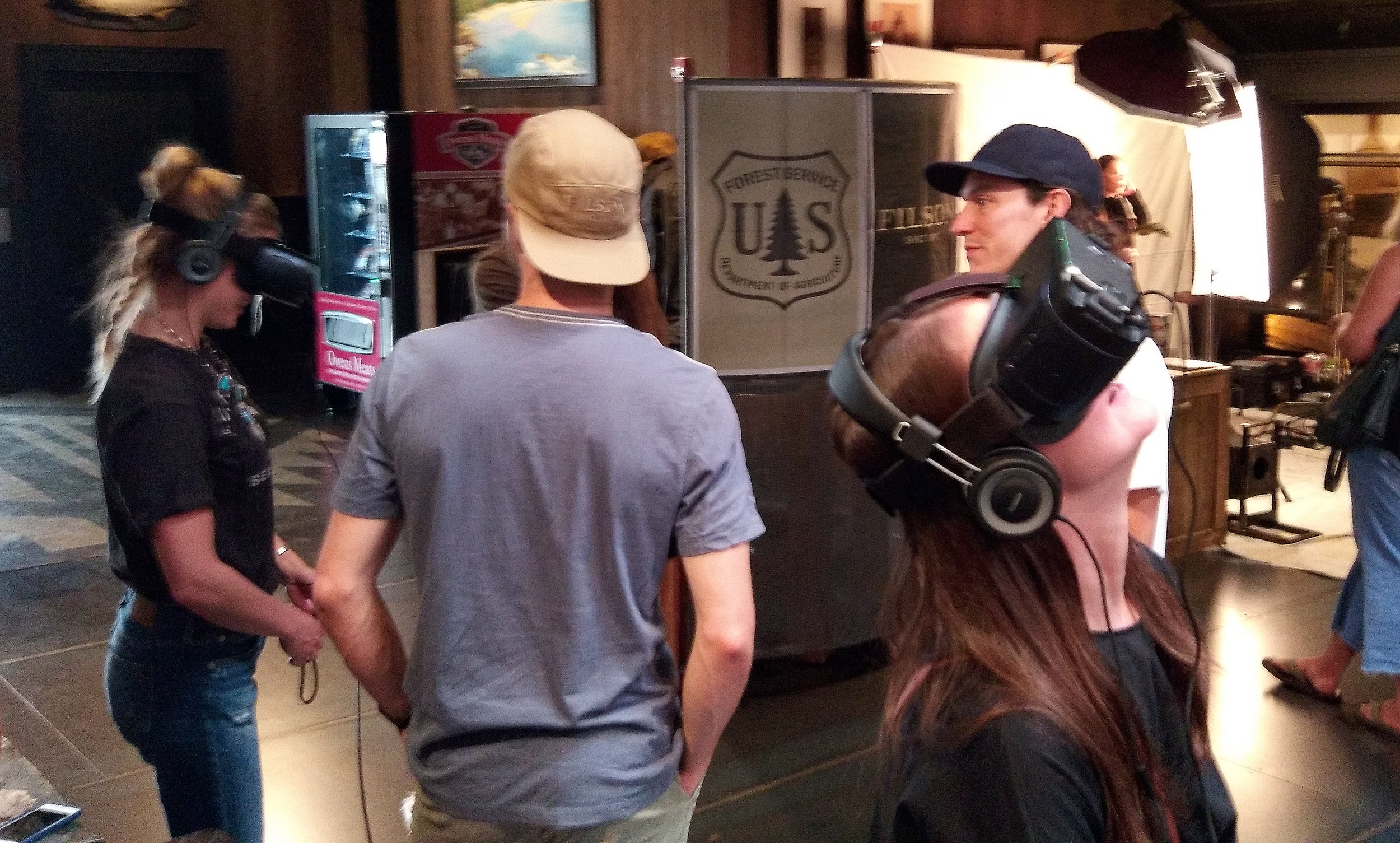 Customers watching the Filson Gear VR experience at the flagship store