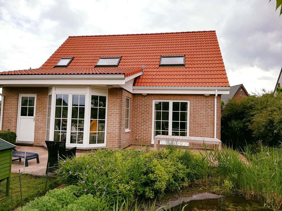 Ontmossen en coating dak - rood - Kortrijk - na.jpg