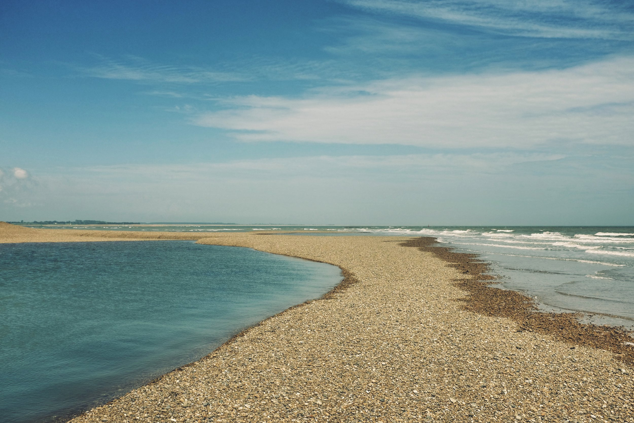 SHINGLE STREET - (10 miles from Woodbridge) is an isolated beach where you can see seals basking at the estuary entrance.No lifeguards