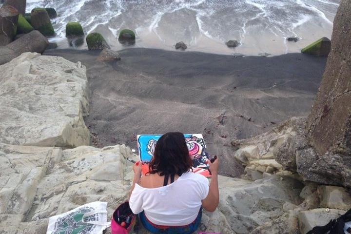 Miranda at the beach creating art.