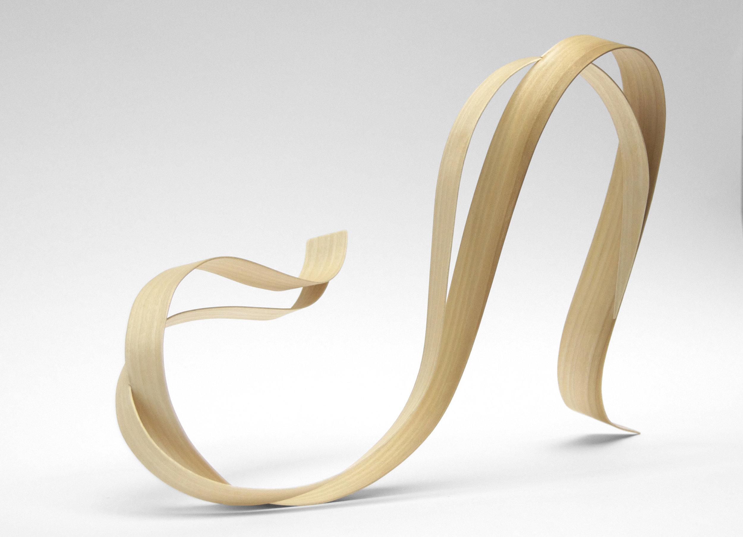 "Experimentation in ""linear flow"" form.Bent veneer."
