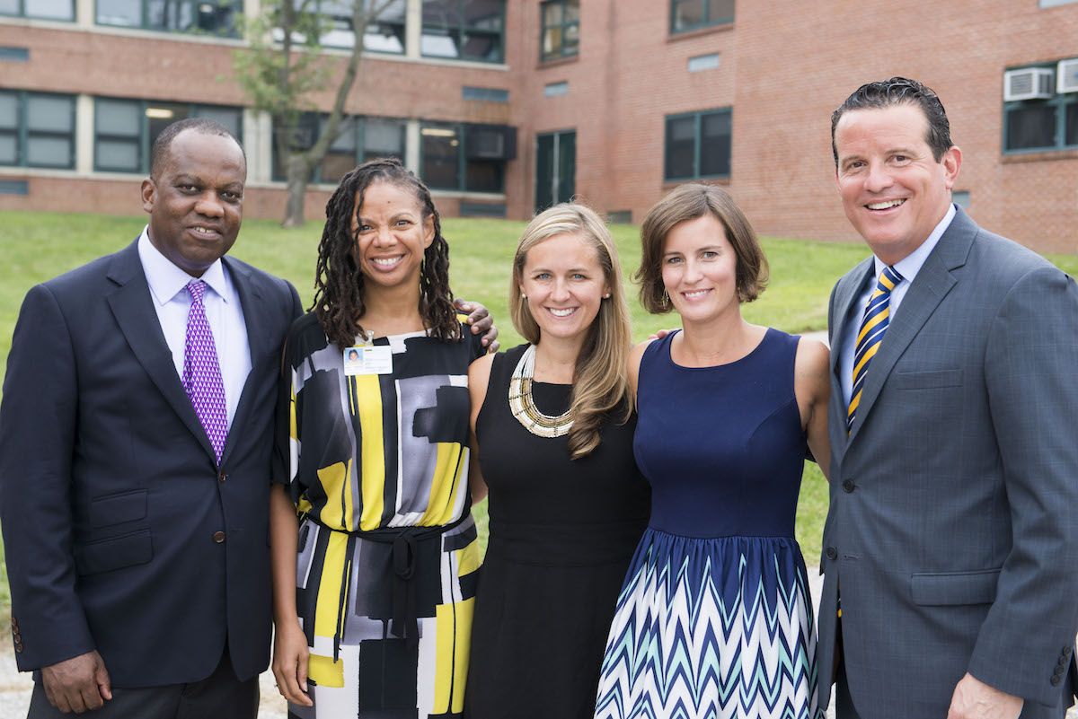 faculty and staff smile for photo at baltimore collegiate school for boys