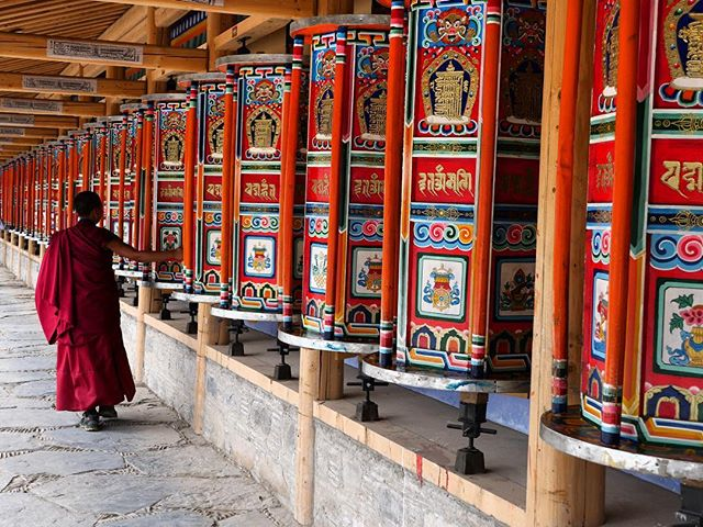 Labrang Monastery is one of the most magical places we've visited, with its thousands of prayer wheels along the 3km Kora. We spent the day following the many Tibetan pilgrims and drinking tea with monks late into the evening. . . . . . . . . #prayerwheel #labrang #labrangmonastery #monk #buddhism #tibet #tibetanplateau #nomad #pilgrim #passionpassport #wanderlust #picoftheday #natgeoyourshot  #bicycletouring #worldbybike