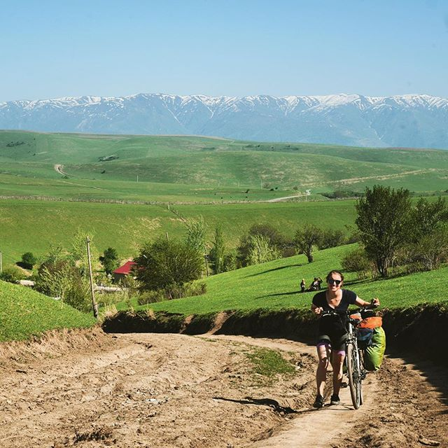People always ask whose idea the trip was, and assume it was mine. In reality Manon was the driving force behind this crazy idea and I'm forever impressed by her ability to always keep smiling. Here's Manon pushing her bike up some horrendously steep dirt roads in rural Kyrgyzstan. Beautiful scenery, brutal cycling! . . . . . . . #bikewander #worldbybike #cycletouring #bikelife #nomad #getoutside #silkroad #kyrgyzstan