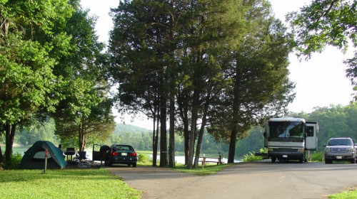 BIG RIDGE CAMPGROUND   Rates:  $25 — $27Taxes and fees are not included. Rates subject to change. $5 reservation fee per site is non-refundable.  Big Ridge has 50 campsites on or near Norris Lake to accommodate RV's, trailers, and tent campers. RV campsites have a paved slip and a soft gravel pad and can accommodate a unit up to 35 feet. Each site has water and 50-amp electrical hookups, picnic table and grill. A dumping station is provided, as well as three bathhouses with restrooms and hot shower facilities. Bathhouses #2 and #3 are closed during the off-season from November 1 to March 31.  Firewood is sold onsite and the camp store is open seasonally.