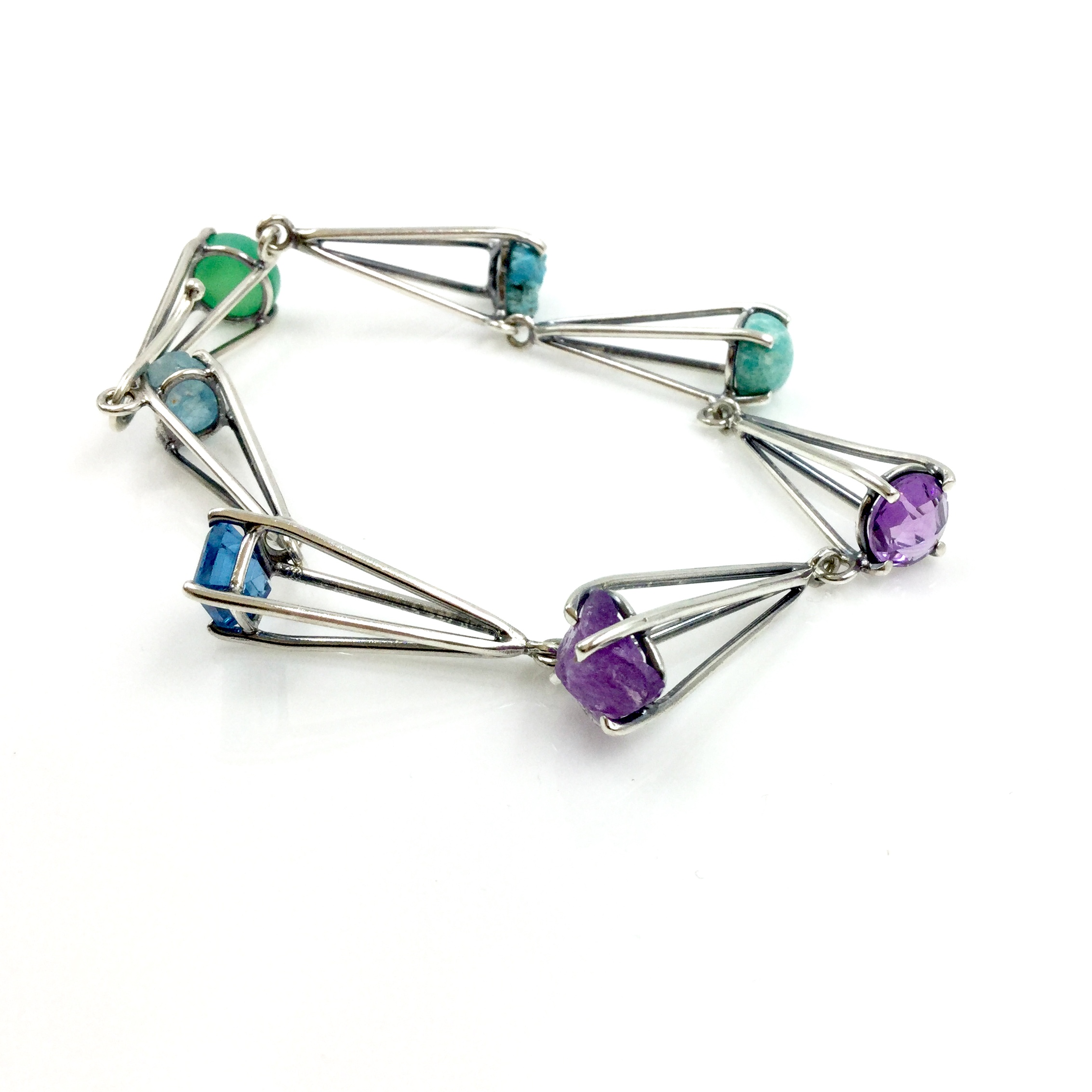 Joanna Gollberg, 7 Stone Set Row Bracelet, rough apatite, blue topaz, rough amethyst, ammonite, rough turquoise, chrysoprase, and sterling silver