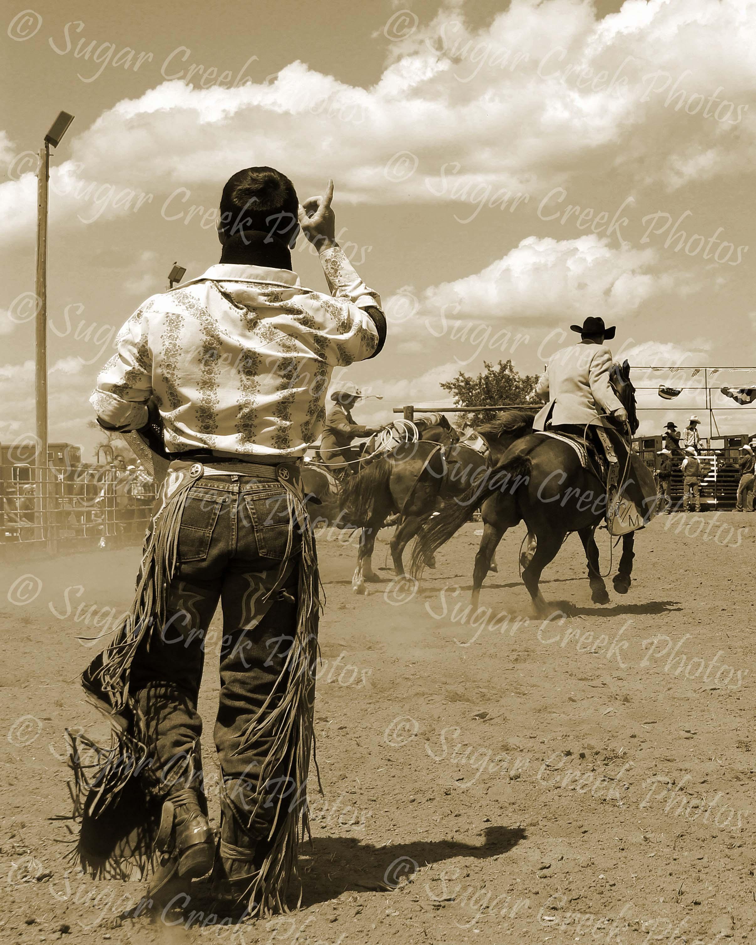 Suits & Chaps - Great shot from Interior, SD during the Stasche Bash in 2016. This is why you always keep shooting even after the ride. Love this shot!! Only one thing would have made it better.....this would have been my husband when he was still riding broncs. One of my favorite rodeo pics for sure!