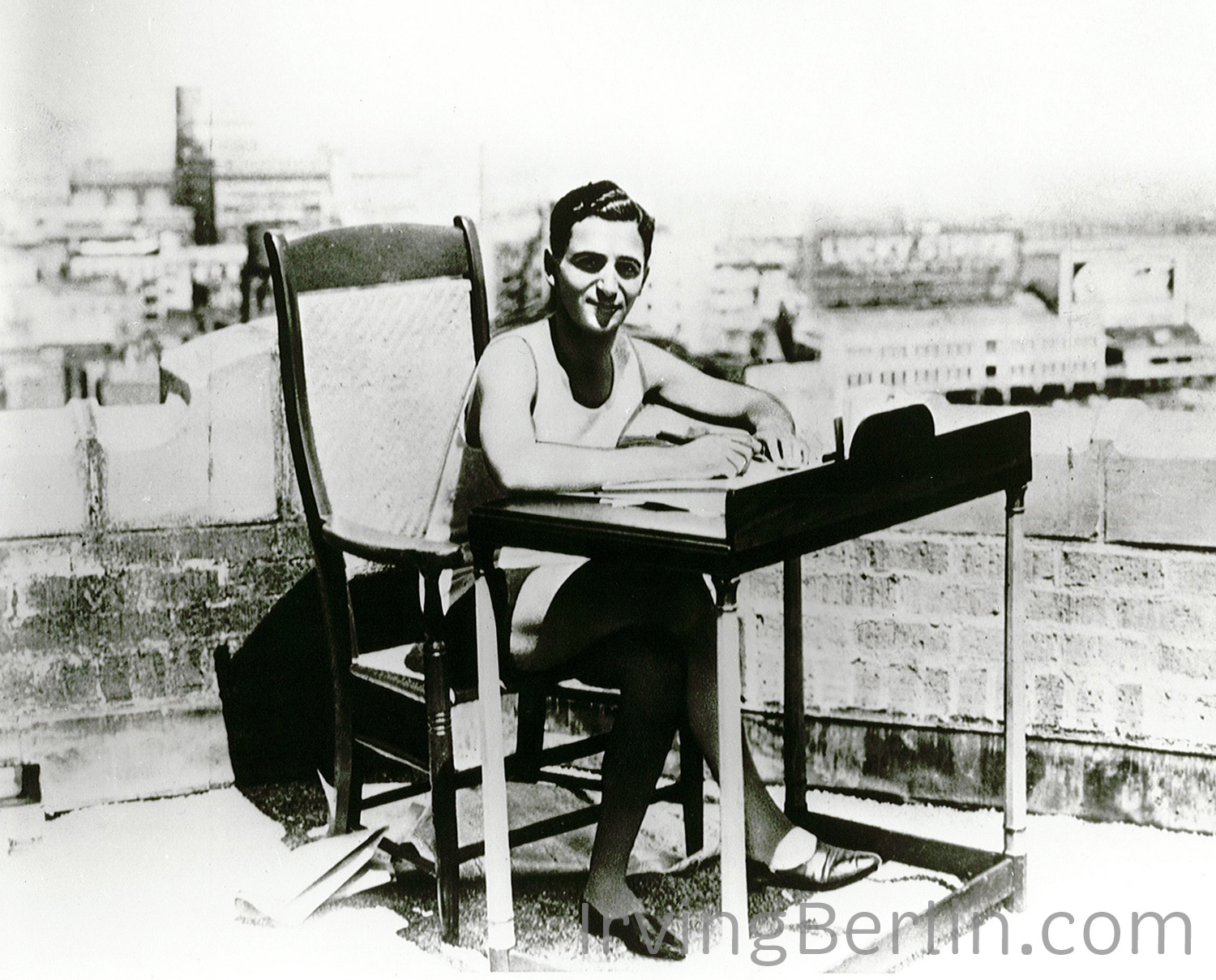 Irving-Berlin-at-desk-on-roof.jpg