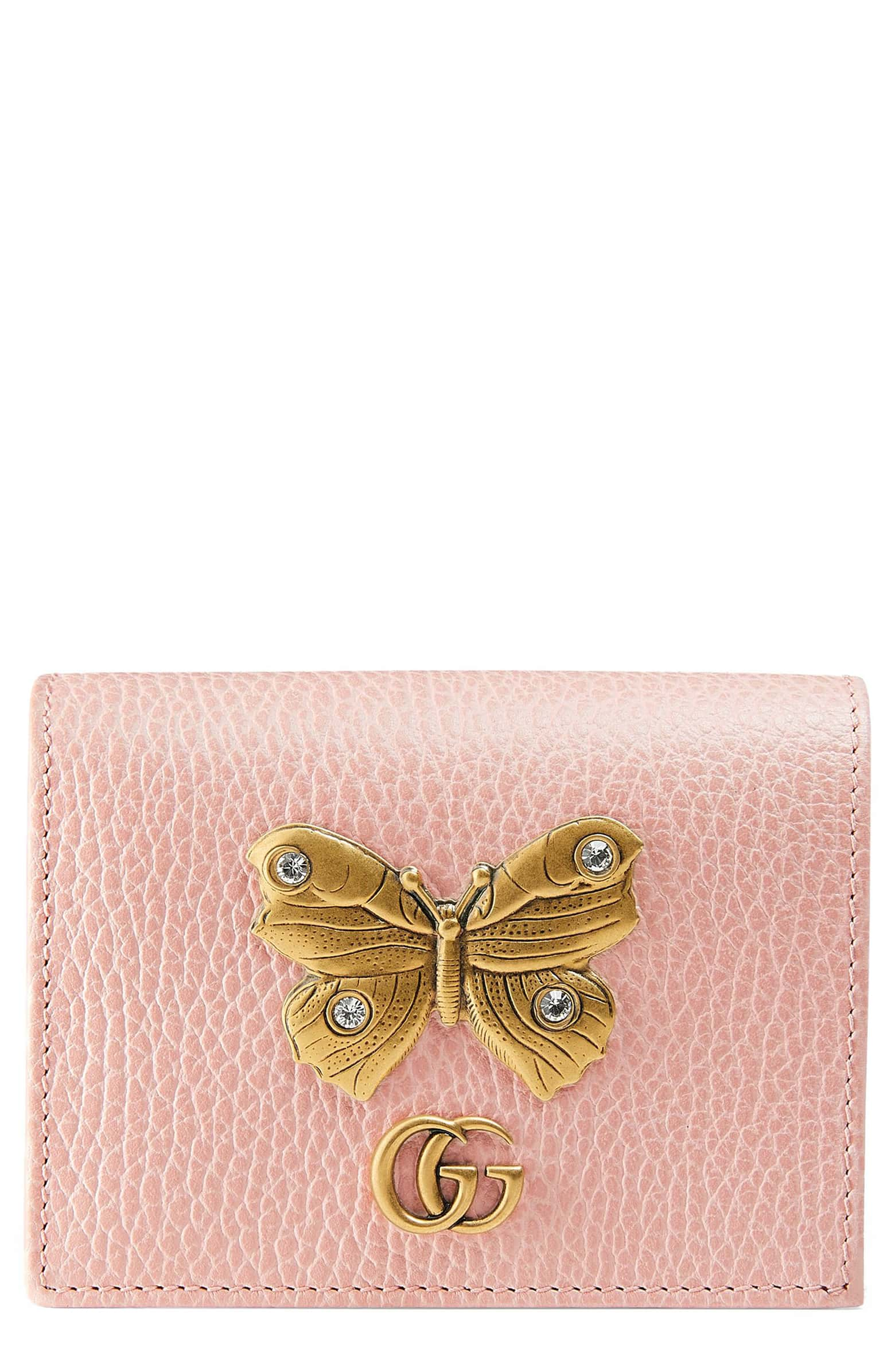 gucci butterfly wallet.jpg