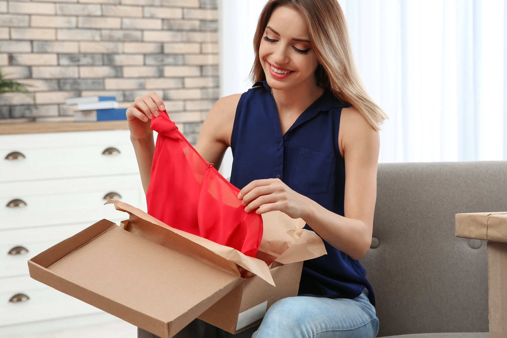 bigstock-Young-Woman-Opening-Parcel-On--284699284.jpg