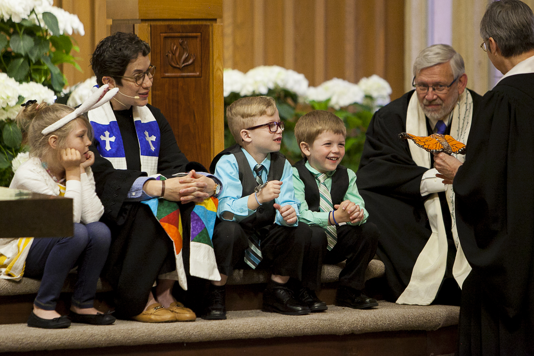 Rev. Lindsey Clifton and Rev. Joe Blankinship enjoy the children's Message with the kids during Sunday morning worship.