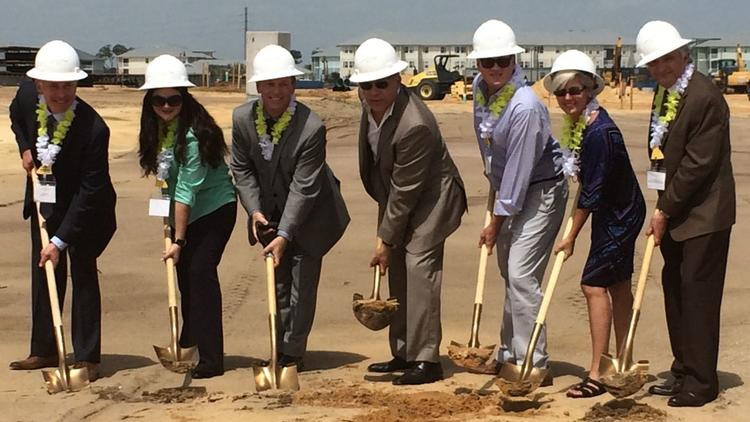 On hand Wednesday morning for a ceremonial groundbreaking at the Margaritaville Resort's hotel site in Osceola County were, from left to right: Don Fisher (county manager), Peggy Choudhry (county commissioner), Jim Bagley (Margaritaville development manager), Art Falcone (Encore CEO), Brandon Arrington (commission chairman), Cheryl Greib (county commissioner) and Abraham Pizam (UCF Rosen College).