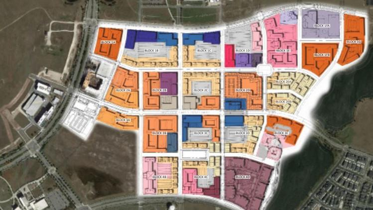This updated Lake Nona Mixed-Use District Fit Plan shows the color-coded uses forecasted for 22 new city blocks that would be developed, bounded by Lake Nona Boulevard, Nemours Parkway and Laureate Boulevard.  (PLACE Alliance)