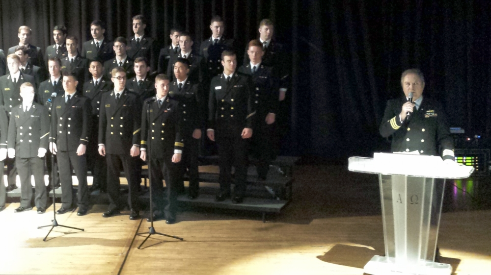 Post 43 member Kevin Glynn, USN (Ret.), far right,introduces the U.S. Naval Academy Men's Glee Club who performed at Los Angeles Senior High School on Friday, March 17. Students were also given information and a chance to ask questions about submitting for nominations to the Academy.  (photo by Randy Kahn)