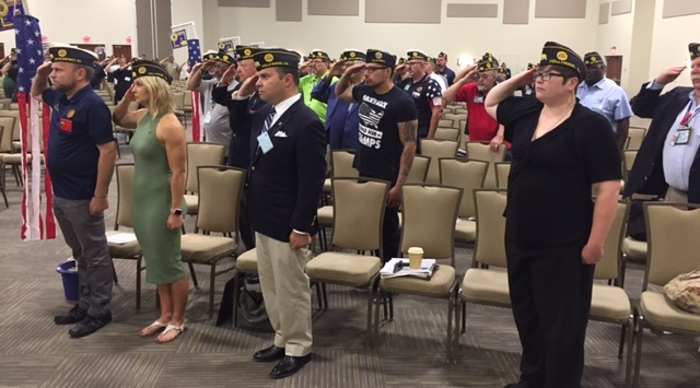 Post 43 delegates saluting the colors