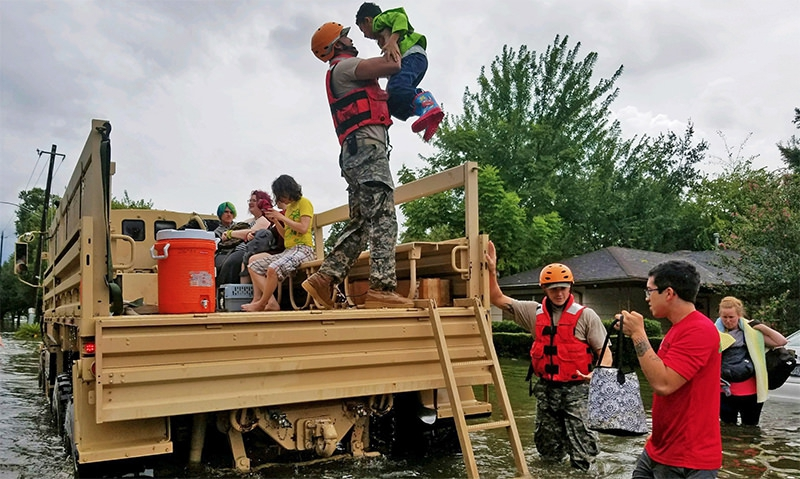 Texas National Guard soldiers assist residents affected by flooding caused by Hurricane Harvey in Houston. (National Guard photo by Lt. Zachary West)