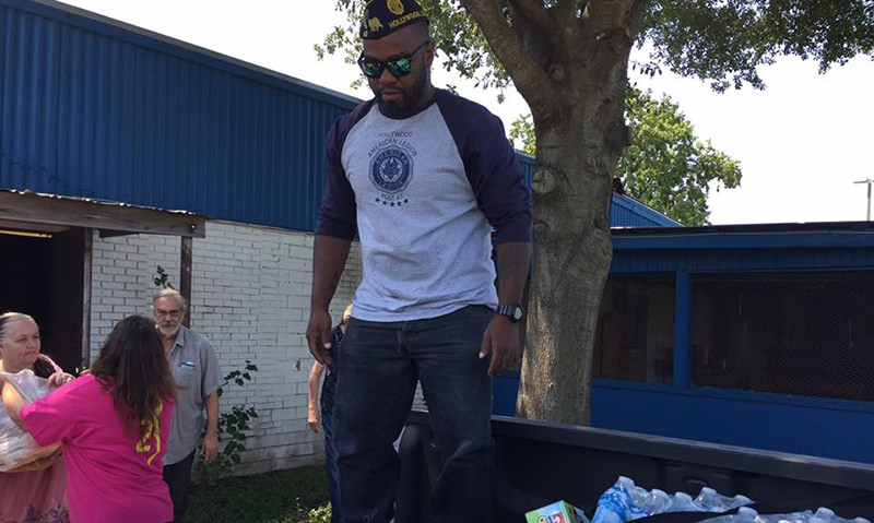 Hollywood Post 43 member Andre Andrews helps distribute water in Texas. Photo by Charles Chavez