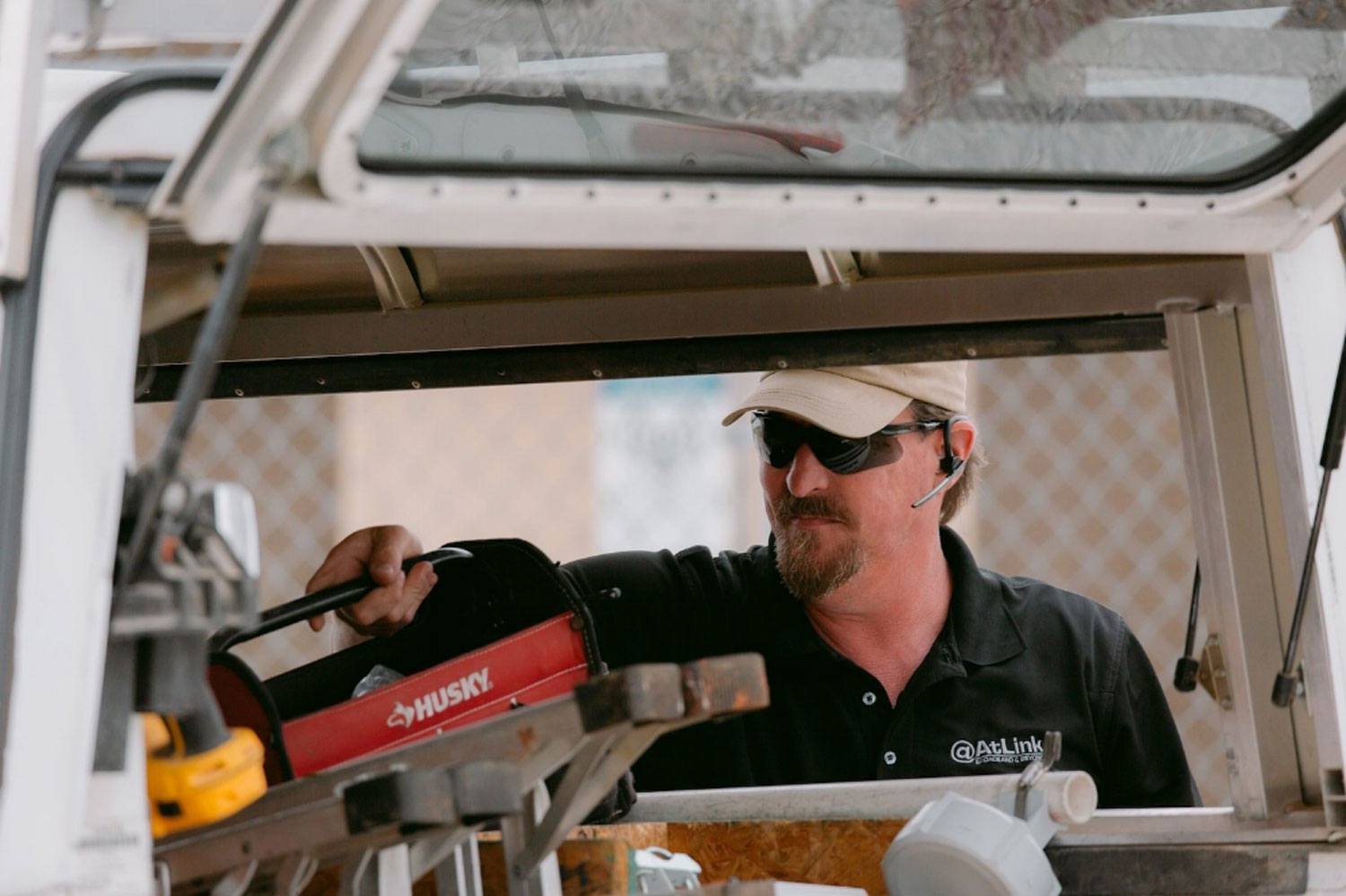 An-AtLink-technician-retrieving-tools-from-his-truck.jpg