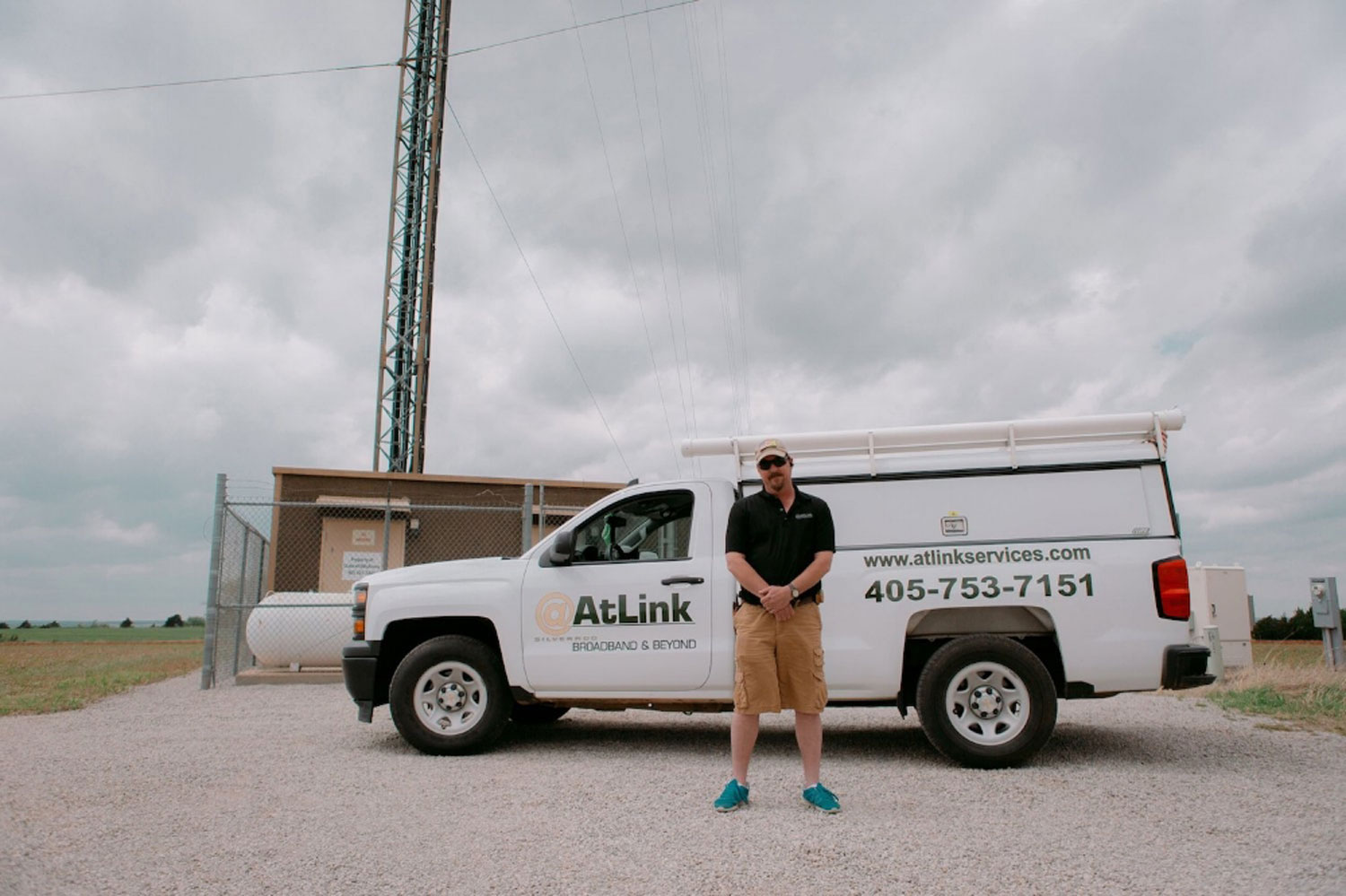An-AtLink-service-technician-standing-in-front-of-his-truck.jpg