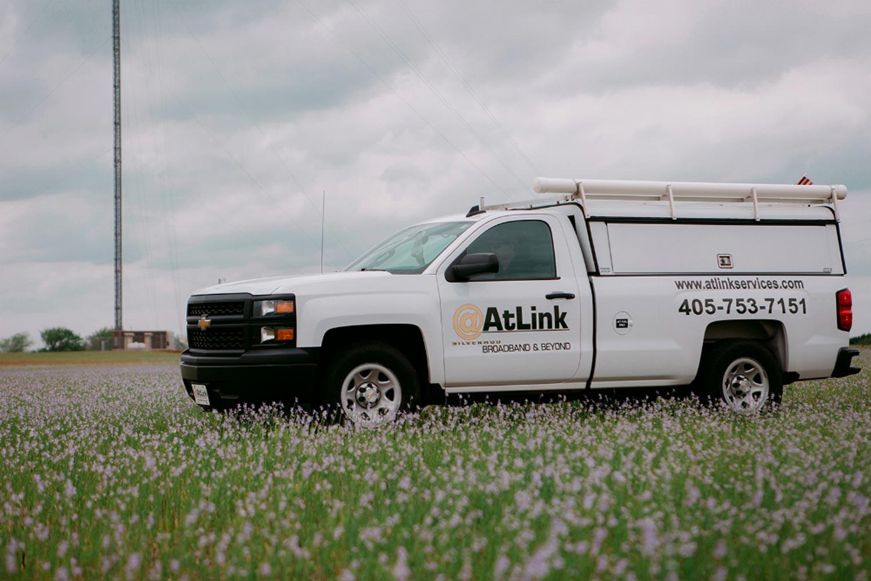 AtLink-service-truck-in-a-field.jpg