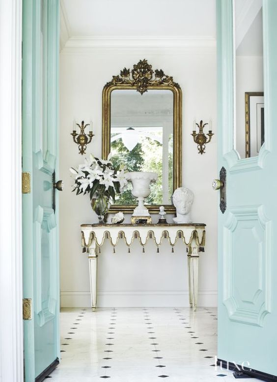 MIRROR, MIRROR - A great console with a grandiose mirror is the ultimate welcome! Mirrors bounce light making interiors look larger, as well as give your guests a perfect glance at someone familiar--themself!