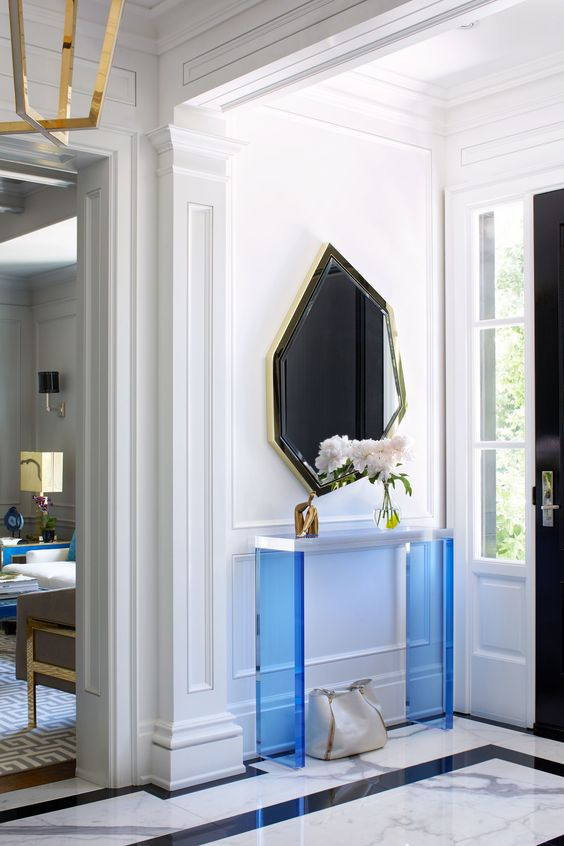 THE UNEXPECTED - Be playful with quirky elements. An interesting console, surprising shapes of a mirror, perhaps your favorite color that is echoed throughout the house! If you love something--buy it--all you're pieces will come together just based off your connection to them!