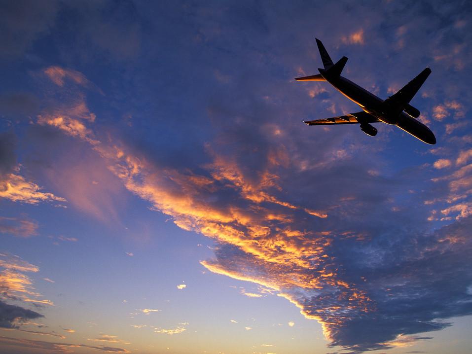 54ff1ce26450ad091fda7432_plane-flying-sunset.jpg