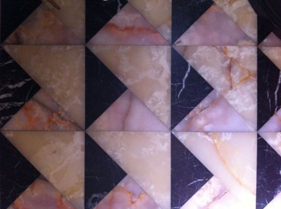 PINK ROCKS - This semi precious stone;used on walls, floors, and counters--has us stopped in our tracks! The way rose quartz seems to glow from within has us wanting an entire powder room done up in it!